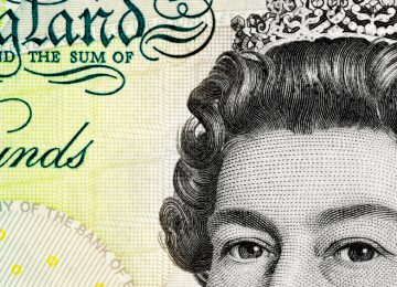 Detail of a british five pound note.