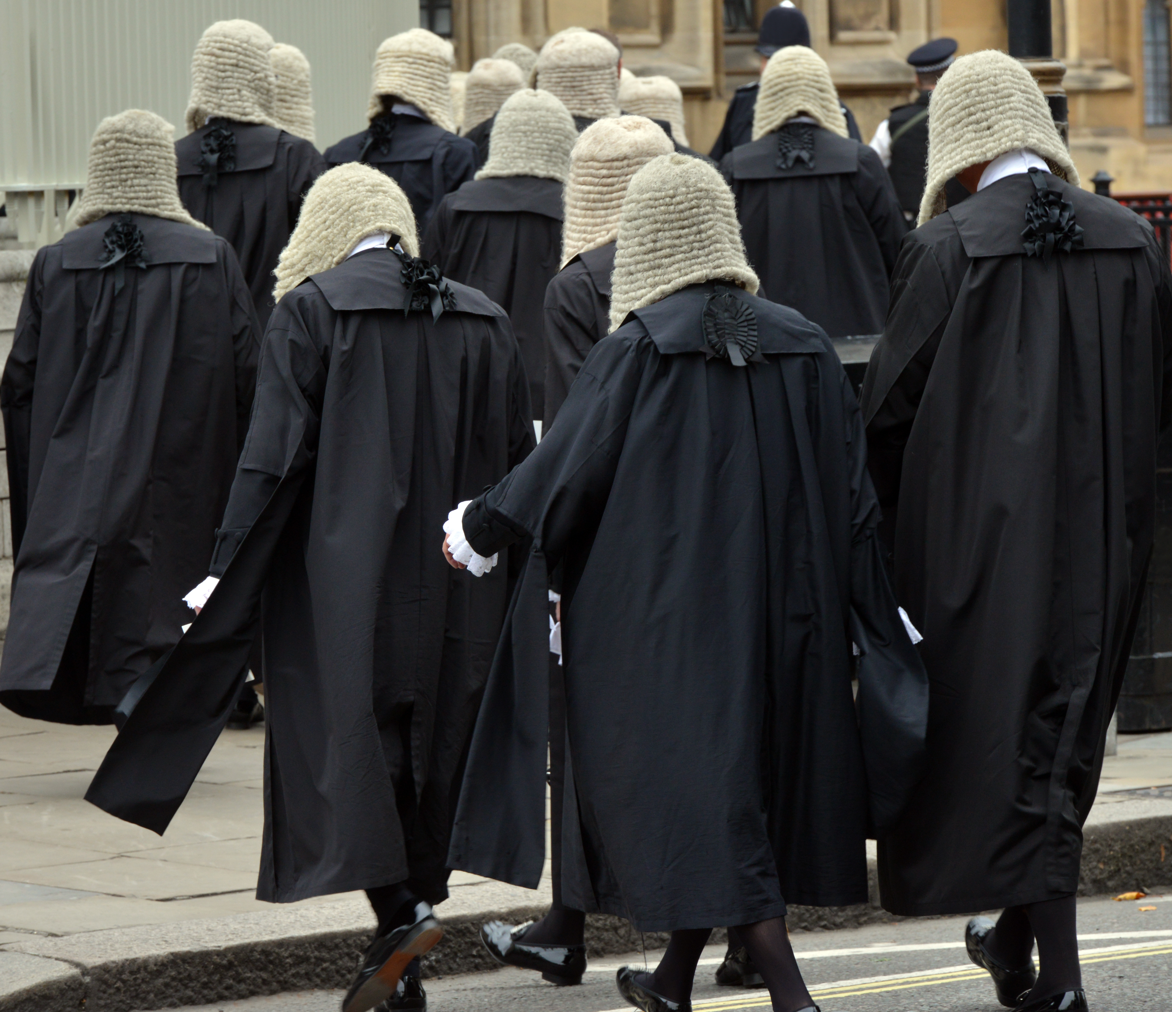 British judges wearing traditional ceremonial wigs and robes in a procession at Westminster, London